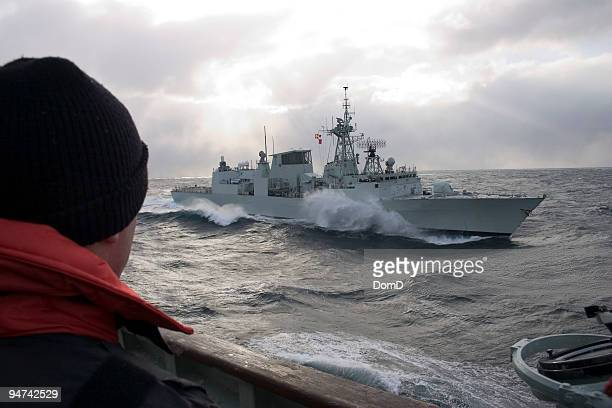 warship in the middle of the sea - warship stock pictures, royalty-free photos & images
