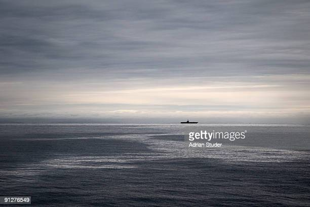 warship under grey sky - warship stock pictures, royalty-free photos & images