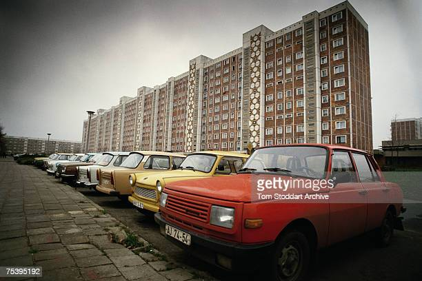 A Wartburg car next to a Trabant possibly in East Germany circa 1990