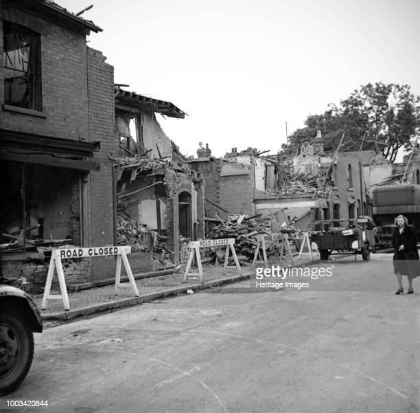Wartime bomb damage, Highgate Road, Sparkbrook, Birmingham, West Midlands, 29 July 1942. Artist James Nelson.