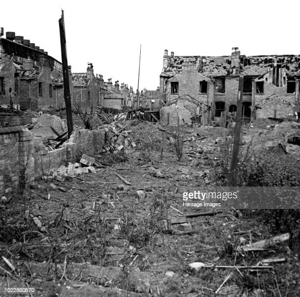Wartime bomb damage Long Acre Nechells Birmingham West Midlands World War II 29 July 1942 View of the rear of Long Acre and Crompton Road showing...
