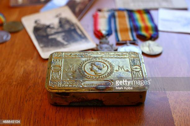 A wartime cake tin from Christmas 1914 belonging to ANZAC veteran Victor Sydney Dowsett is seen in his son Peter Dowsetts home on March 30 2015 in...