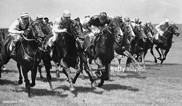A wartime Derby run at Newmarket with a closely bunched field two furlongs from home On the left is Salim Hassan Morogoro who came second ridden by...