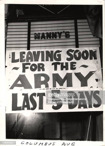 Wartime New York impacted many businesses like this store Manny's on Columbus Avenue which has a sign on the window reading 'Leaving Soon For The...