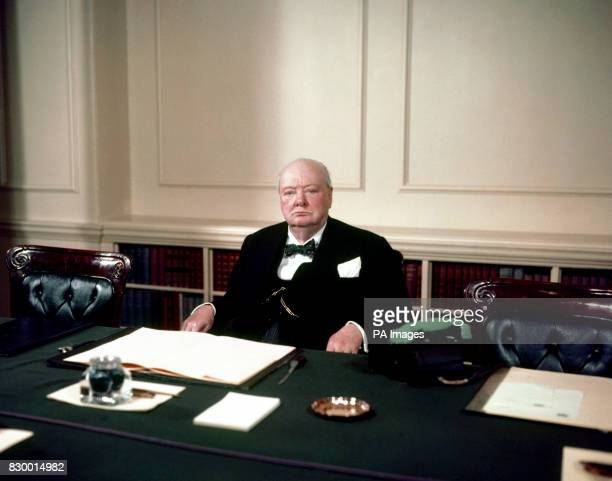 War-time prime minister, Sir Winston Churchill, at his desk. 8/5/98 Members of his family gathered in Bladon churchyard, Oxfordshire to rededicate...