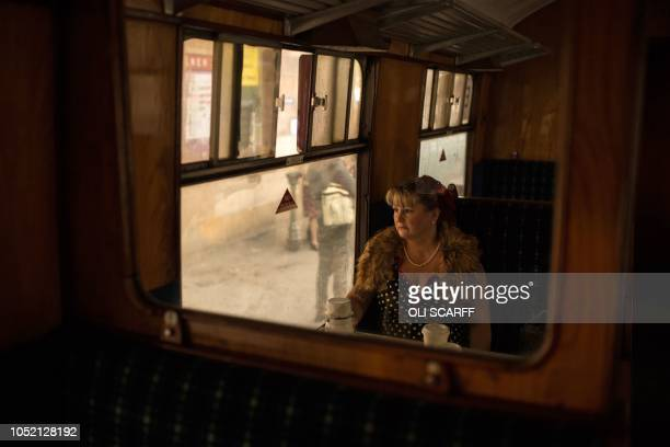 TOPSHOT A wartime reenactor takes a train journey during a reenactmentthemed weekend the annual 'Railway in Wartime' event held along the North...