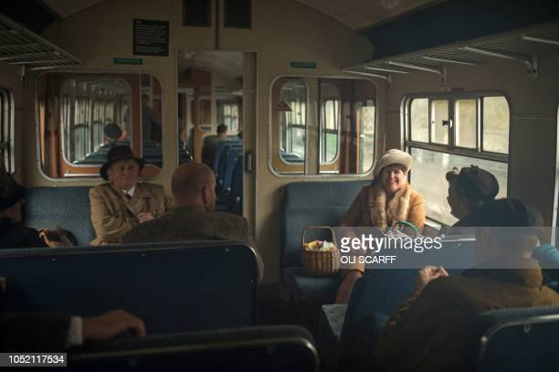 TOPSHOT Wartime reenactors take a train journey during a reenactmentthemed weekend the annual 'Railway in Wartime' event held along the North...