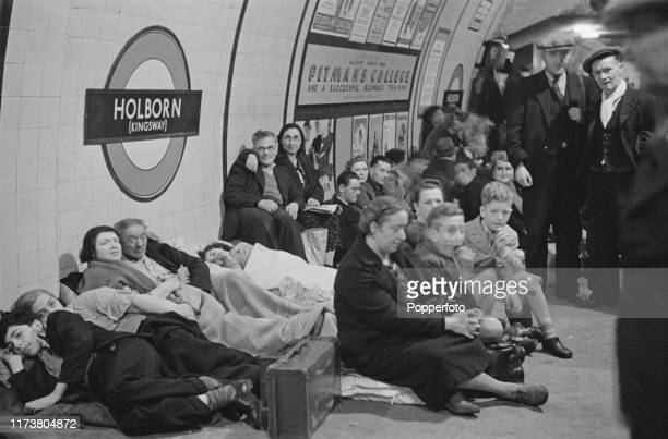 Wartime scene as Londoners seek shelter and bed down on the platform at Holborn underground station to escape from German Luftwaffe air raids during...