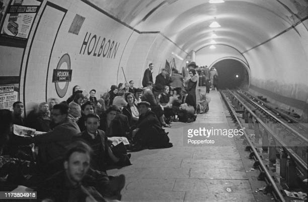 Wartime view of Londoners seeking shelter and bedding down on the platform at Holborn underground station to escape from German Luftwaffe air raids...