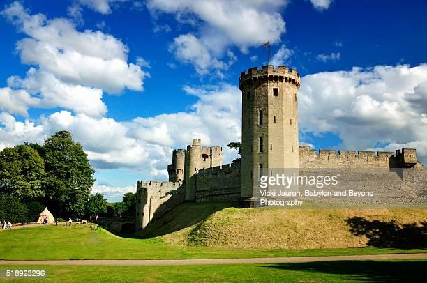 warwick castle against a beautiful blue sky with clouds - warwick castle bildbanksfoton och bilder