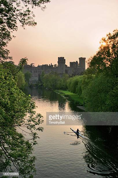 warwick castle at sunset - warwick uk stock photos and pictures