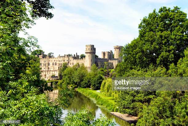 Warwick Castle is a medieval castle in Warwick the county town of Warwickshire England It sits on a cliff overlooking a bend in the River Avon