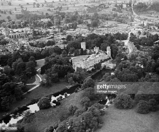 Warwick Castle Warwickshire 1920 Aerial view of the castle with the River Avon in the foreground with the church and town beyond Artist Aerofilms