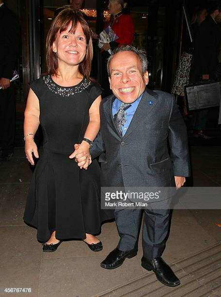 Warwick Davis and Samantha Davis attend the Pride of Britain awards at The Grosvenor House Hotel on October 6 2014 in London England