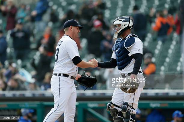 Warwick Saupold of the Detroit Tigers celebrates with catcher James McCann of the Detroit Tigers after a win over the Kansas City Royals at Comerica...