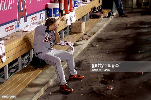 Warwick Saupold of the Detroit Tigers wipes his face in the dugout during the fifth inning of a game against the Los Angeles Angels of Anaheim at...
