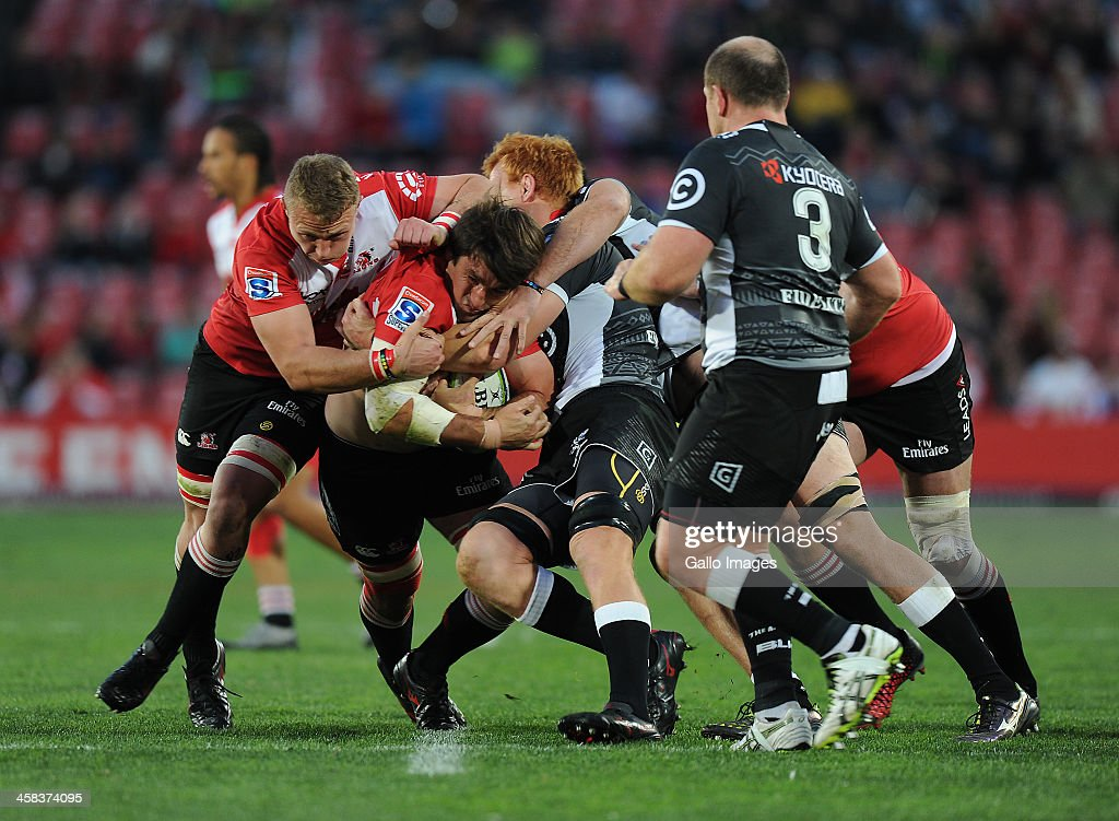 Warwick Tecklenburg of Lions is tackled by Philip van der Walt of Sharks during the Super Rugby match between Emirates Lions and Cell C Sharks at Emirates Airline Park on July 02, 2016 in Johannesburg, South Africa.