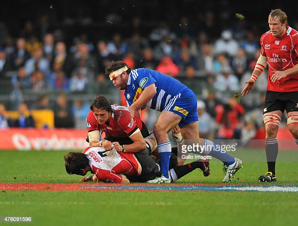 Warwick Tecklenburg of the Lions tackled by Frans Malherbe of the Stormers during the Super Rugby match between DHL Stormers and Emirates Lions at...