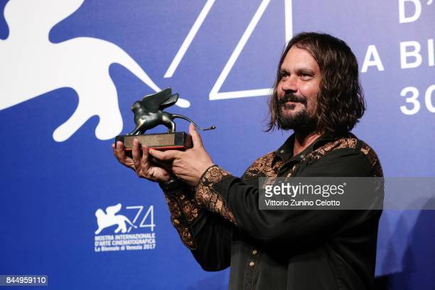 Warwick Thornton poses with the Special Jury Prize Award for 'Sweet Country' at the Award Winners photocall during the 74th Venice Film Festival at...
