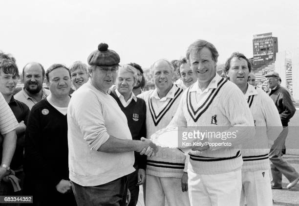 Warwickshire and England cricketer Dennis Amiss is presented with a commemorative salver by the groundstaff on the last day of his final firstclass...