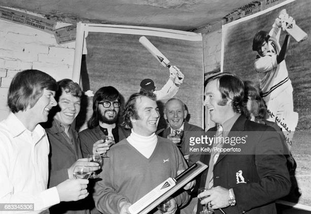 Warwickshire and England cricketer Dennis Amiss is presented with a commemorative bat by bat manufacturer Duncan Fearnley at the Duncan Fearnley...