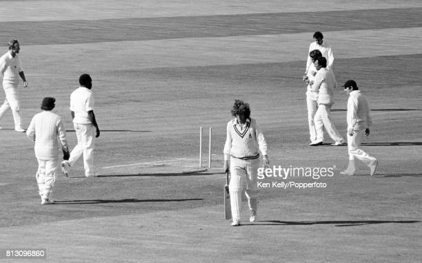 Warwickshire batsman Bob Willis walks off after being bowled by Bob Woolmer of Kent being congratulated by his captain Asif Iqbal on the final day of...