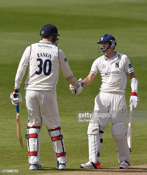 Warwickshire batsman Chris Wright and Boyd Rankin celebrate their 100 partnership for the 9th wicket during day three of the LV County Championship...
