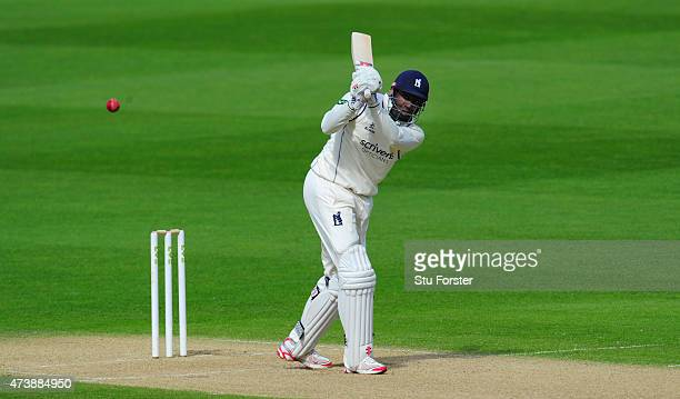 Warwickshire batsman Keith Barker hits out during his century durind day two of the LV County Championship Division One match between Wwarwickshire...