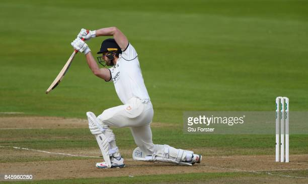 Warwickshire batsman Matthew Lamb drives to the boundary during day one of the Specsavers County Championship Division One match between Warwickshire...