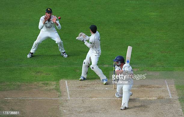 Warwickshire batsman Tim Ambrose is caught by slip Alex Hales as keeper Chris Read looks on during day three of the LV County Championship Division...