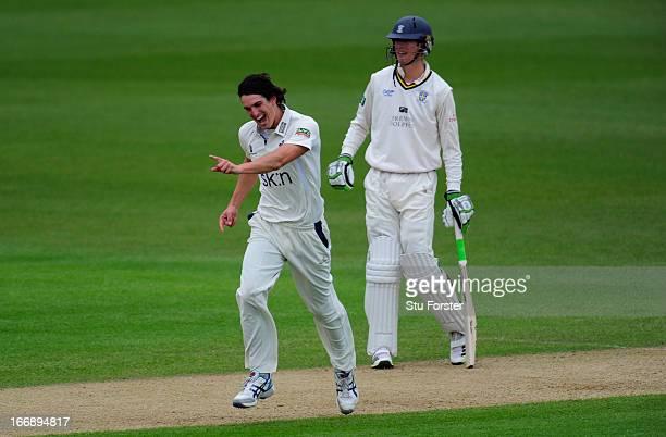 Warwickshire bowler Chris Wright celebrates after taking the wicket of Durham batsman Dale Benkenstein as fellow batsman Keaton Jennings looks on...