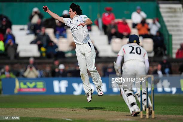 Warwickshire bowler Chris Wright fields a ball off his own bowling from a shot by Paul Horton during day one of the LV County Championship division...