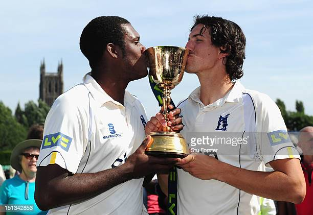 Warwickshire bowlers Keith Barker and Chris Wright kiss the trophy after winning the LV County Championship Division One title after day three of the...