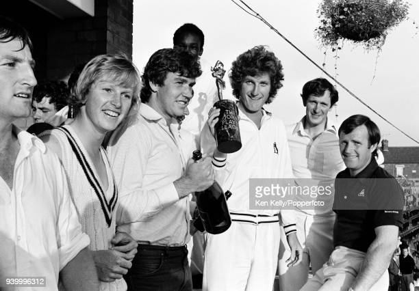 Warwickshire captain Bob Willis and teammates celebrate winning the John Player League after victory in the match against Leicestershire at Grace...