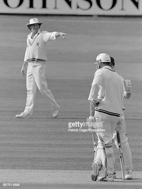 Warwickshire captain Dermot Reeve directing the field as Worcestershire batsmen Graeme Hick and Tom Moody have a midpitch chat during the NatWest...