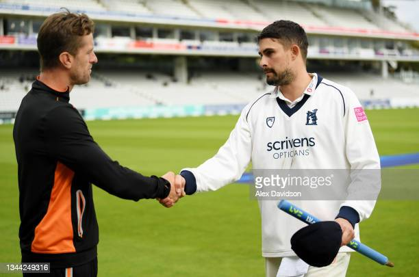 Warwickshire captain Will Rhodes shakes hands with Lancashire captain Dane Vilas after Day 4 of the Bob Willis Trophy Final between Warwickshire and...