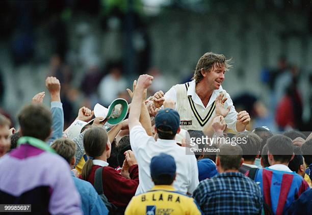 Warwickshire cricket captain Dermot Reeve is congratulated by supporters after his team beat Kent in the semifinal of the NatWest Trophy at Lord's...