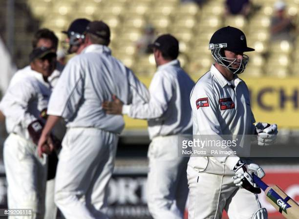 Warwickshire players celebrate in the background as Yorkshire batsman Craig White walks off dejected after being caught out by Warwickshire's Dominic...