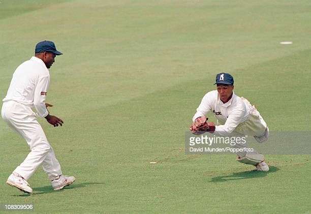 Warwickshire wicketkeeper Keith Piper dives to catch the ball watched by Brian Lara during the Benson Hedges Cup Final between Warwickshire and...