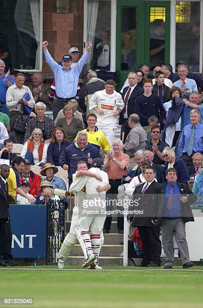 Warwickshire's Dougie Brown hugs teammate Neil Carter after he hit a boundary off the last ball of the match to win the Benson and Hedges Cup Semi...
