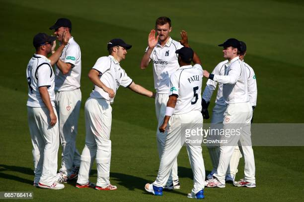 Warwickshire's Oliver HannonDalby celebrates with team mates after taking the wicket of Scott Borthwick during the Specsavers County Championship...