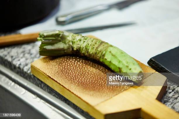 wasabi on the wasabi grater - wasabi sauce stock pictures, royalty-free photos & images