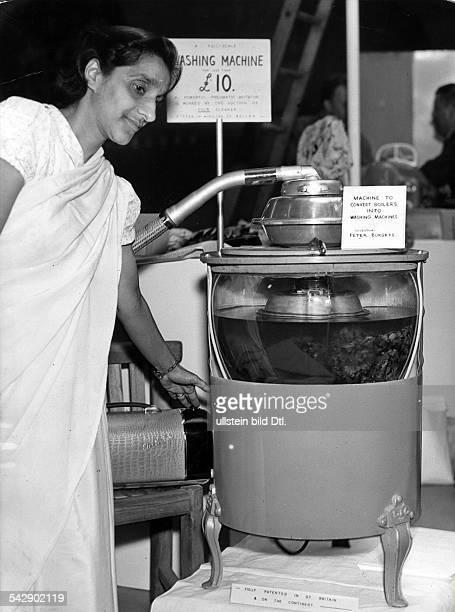 Waschmaschine auf der britischen Industrieausstellung durch einen angeschlossenen Staubsauger wird ein Boiler in eine Waschmaschine umfunktioniert...