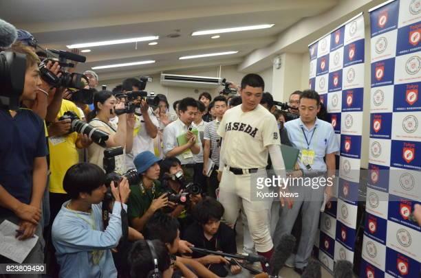 Waseda Jitsugyo high school baseball slugger Kotaro Kiyomiya is surrounded by reporters after a 41 win over Hachioji at Jingu Stadium on July 28 in...