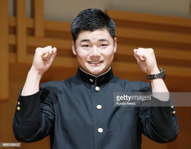 Waseda Jitsugyo High School slugger Kotaro Kiyomiya poses during a press conference in Kokubunji Tokyo on Oct 26 2017 after being selected by the...