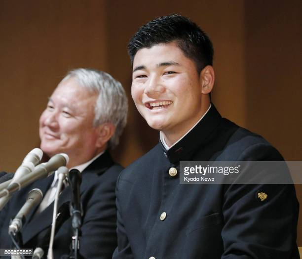 Waseda Jitsugyo High School slugger Kotaro Kiyomiya smiles during a press conference after being selected by the Pacific League's Nippon Ham Fighters...