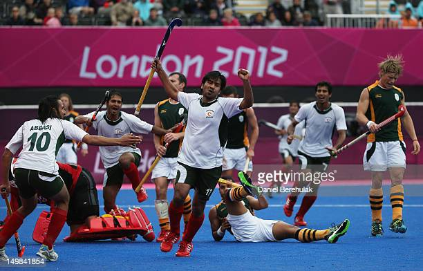 Waseem Ahmad of Pakistan celebrates after scoring the match winning goal against South Africa by 5 goals to 4 during the Men's Hockey match between...
