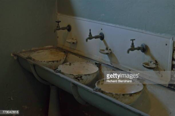 Wash basins at the Buchenwald German Nazi concentration camp near Weimar Germany 2014 The site is now a museum and memorial