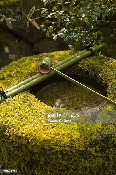 washbasin with ladle - kazuko kimizuka stock pictures, royalty-free photos & images