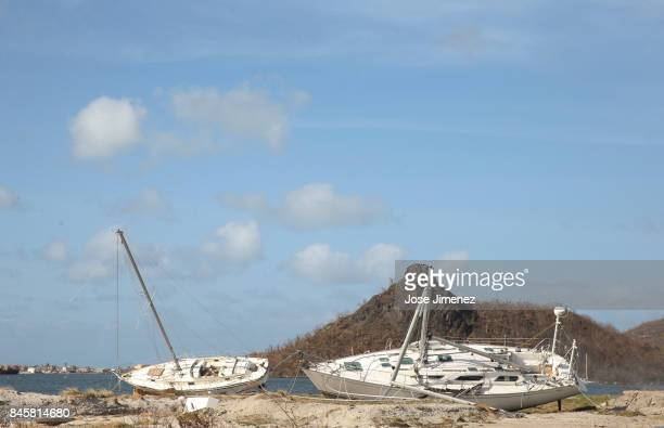 Washed ashored sailboats rest on the neach in Simpson Bay on September 11 2017 in Philipsburg St Maarten The Caribbean island sustained extensive...